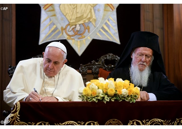 Pope Francis and the Ecumenical Patriarch, Bartholomew I, sign the Joint Declaration - AP